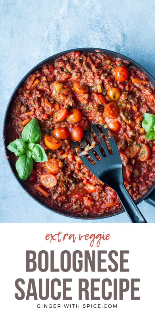 Tomato and meat sauce in a skillet, blue background. Pinterest pin.