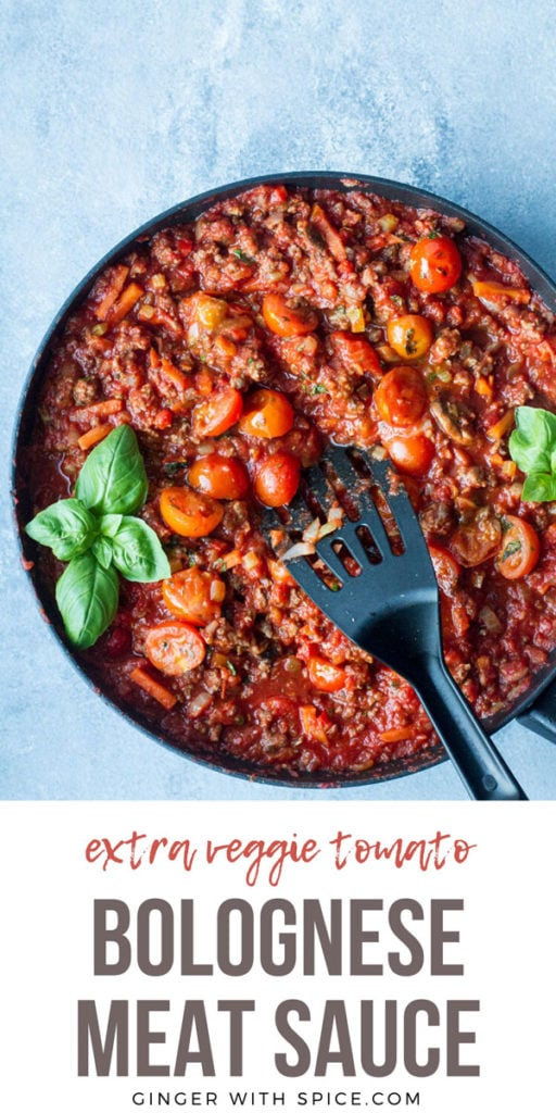 Bolognese sauce in a large skillet, garnished with fresh basil. Blue background. Pinterest pin with text.