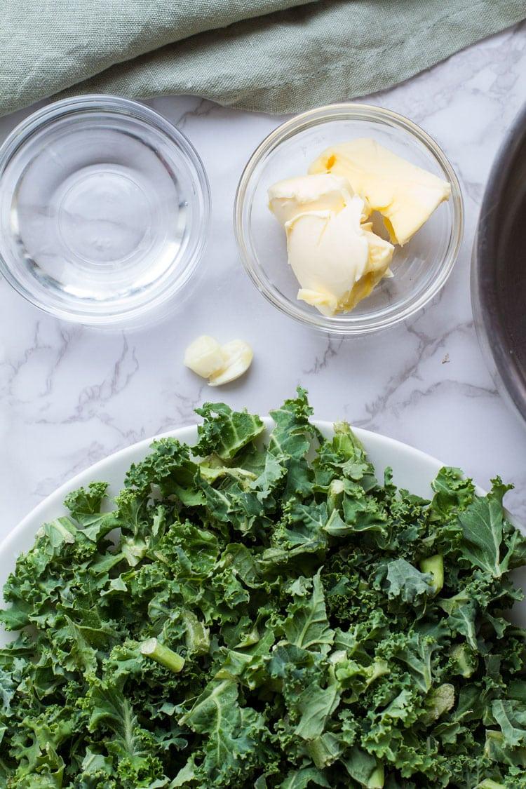 Ingredients to make garlic butter wilted kale.