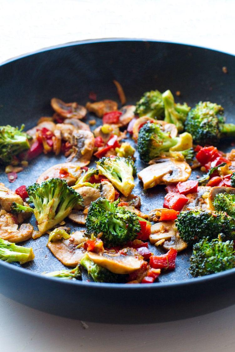 Sautéed vegetables in skillet.