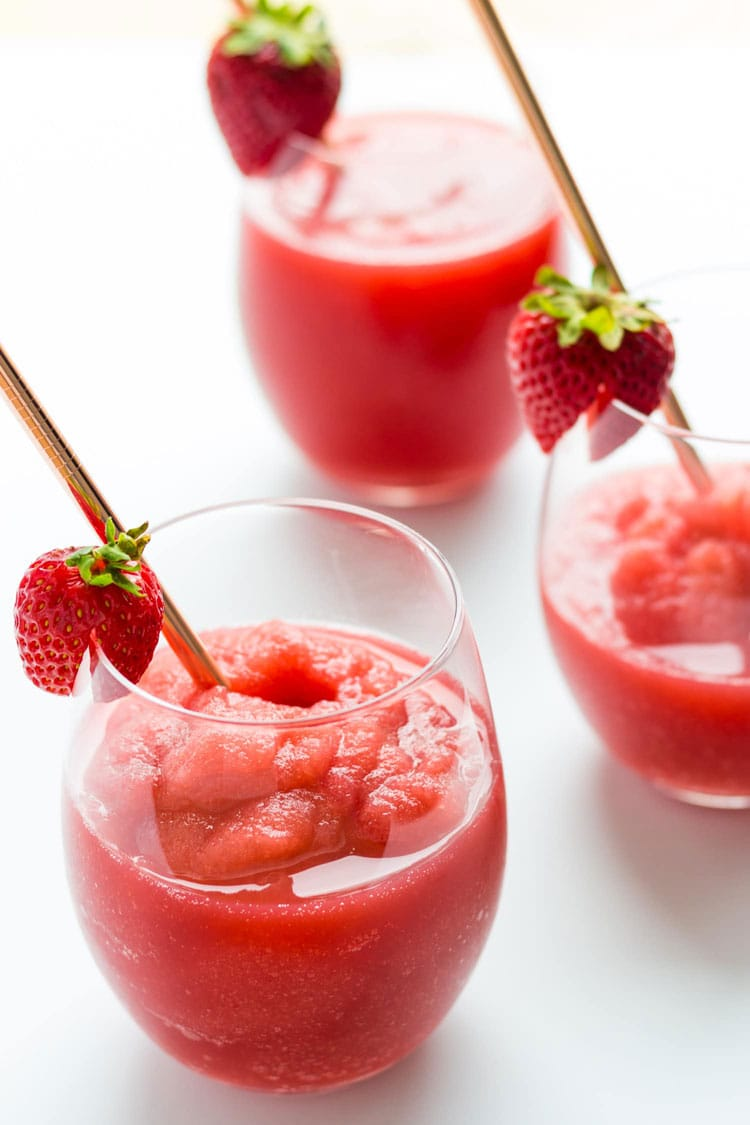 3 wine glasses with strawberry slush frosé.