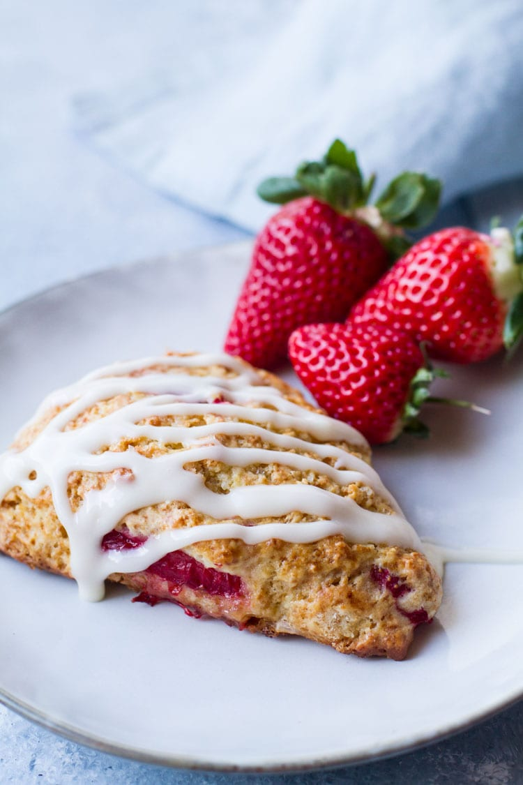 Strawberry scone with cream cheese glazing.