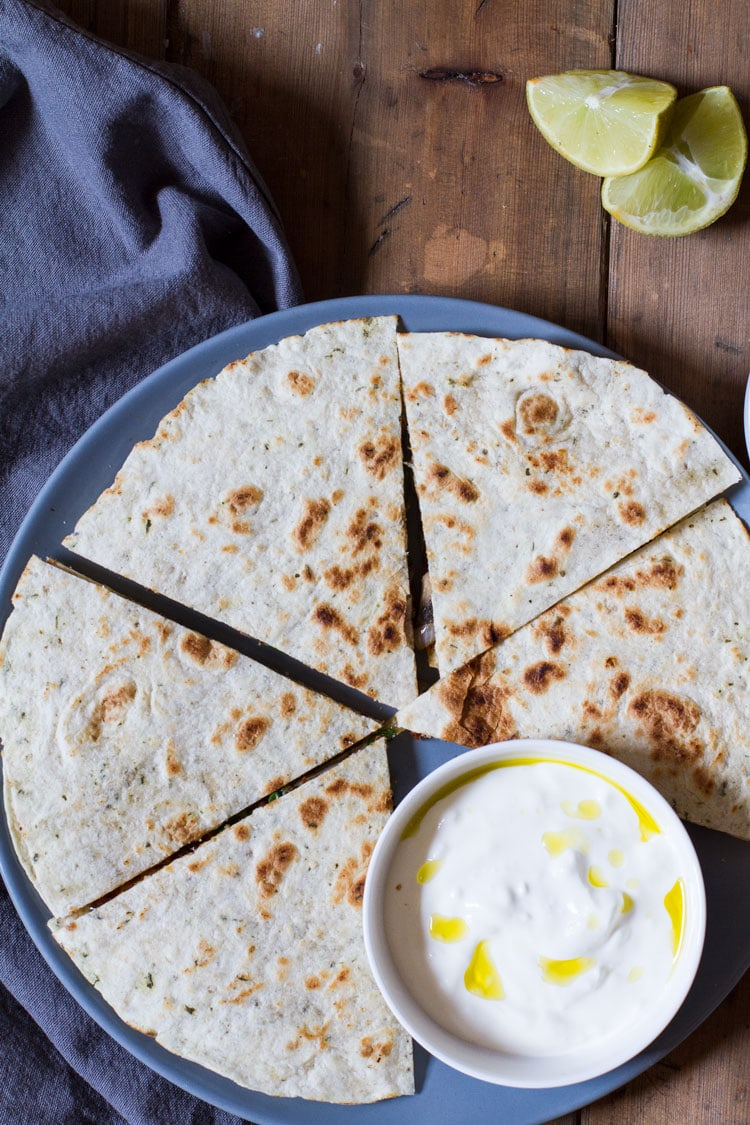 Quesadilla cut in 8, sour cream on the side.