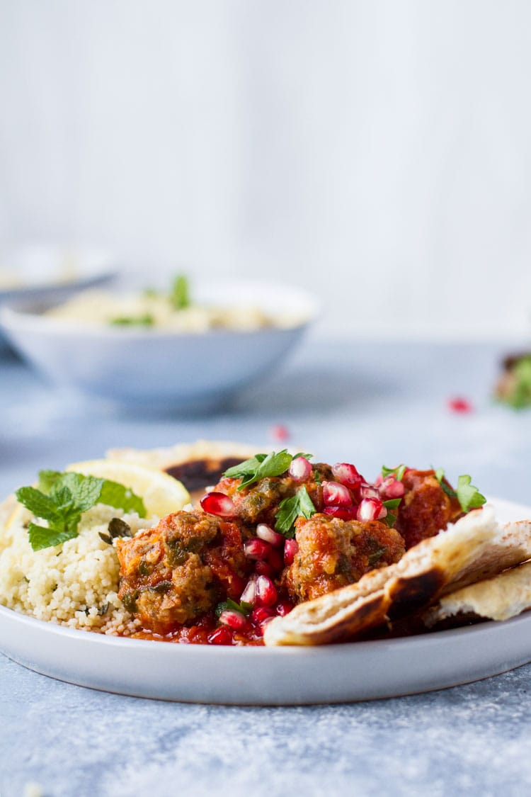 Serving suggestion with mint and pomegranate. Blue background.