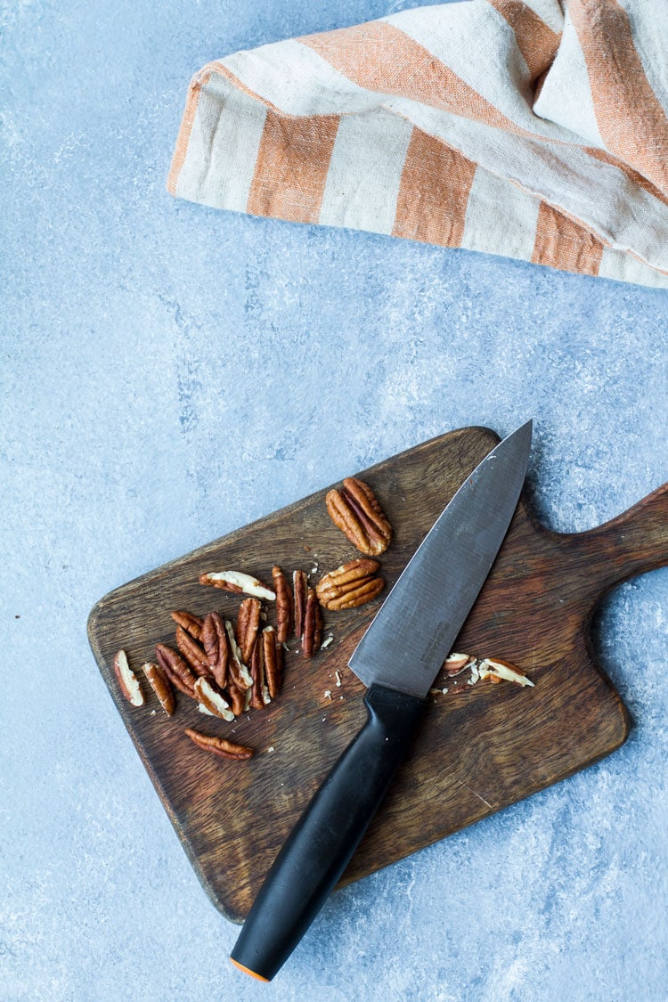 How to slice pecans, on a cutting board.