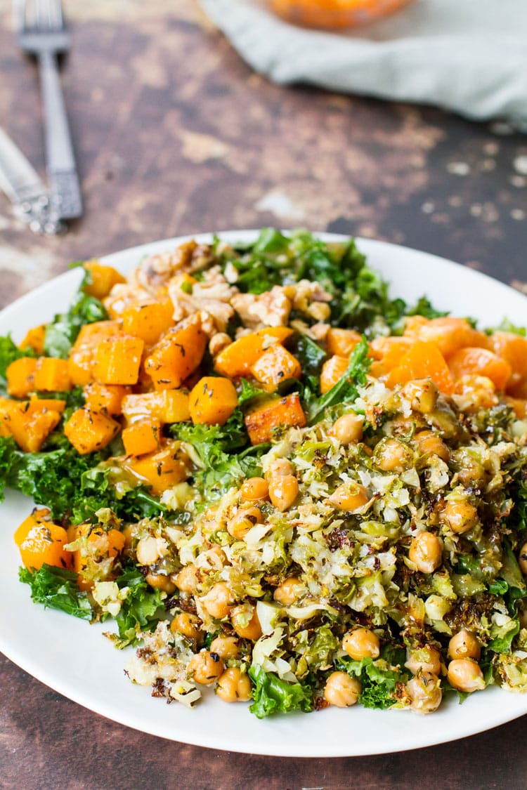 Butternut squash kale salad on a white plate.
