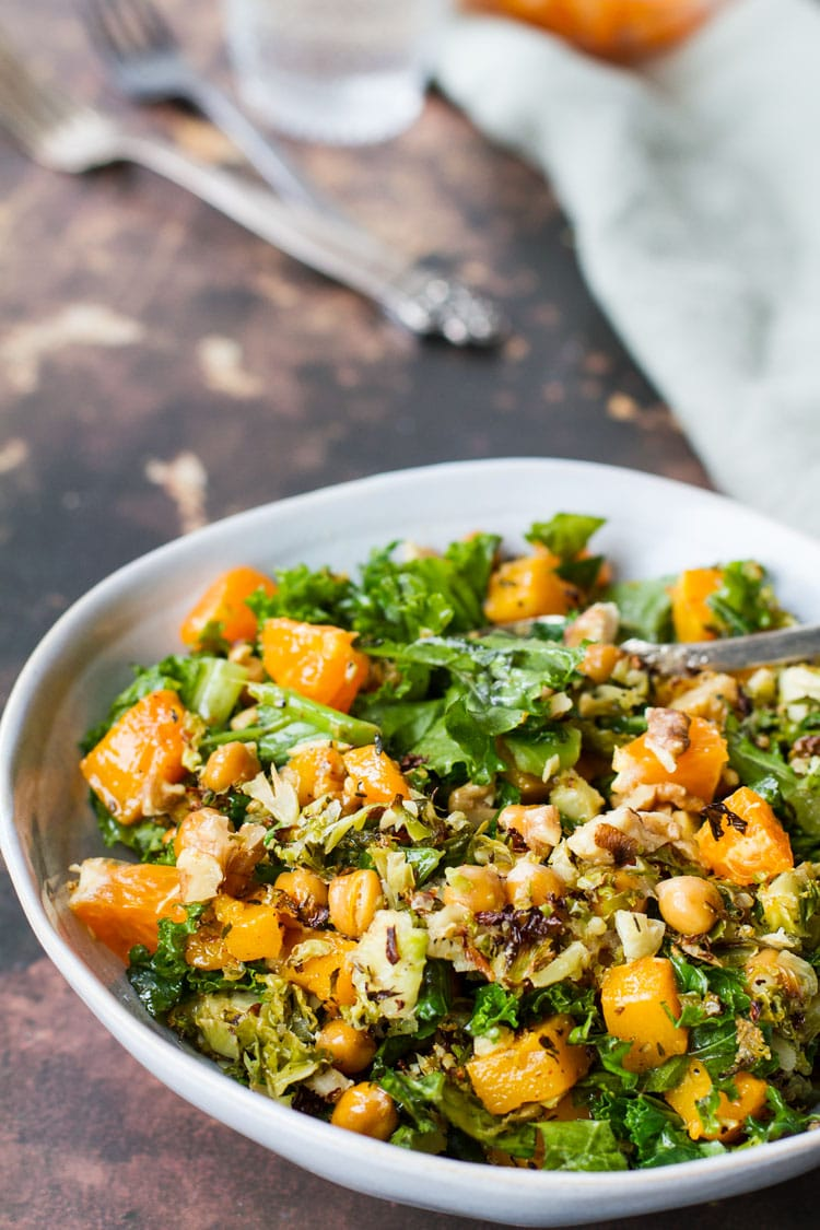 A serving bowl of salad with butternut squash.